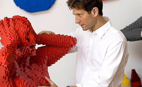 Nathan Sawaya and one of his Brick Men. Photo courtesy of ArtScience Museum.