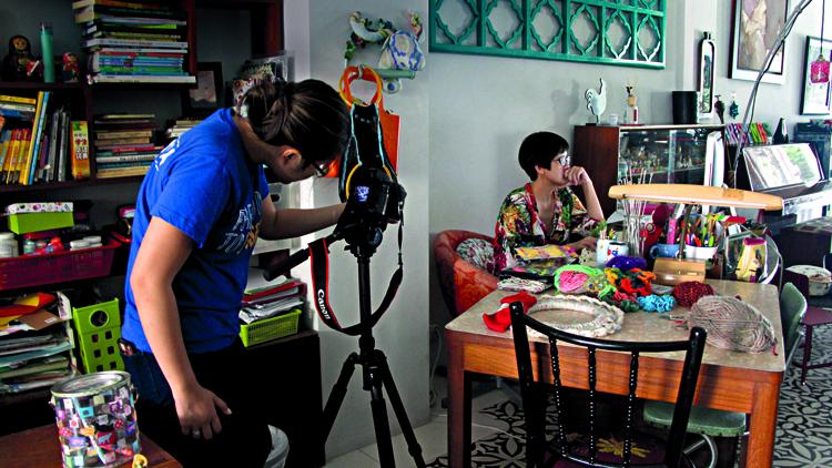 Actress Karen Tan getting her portrait taken.